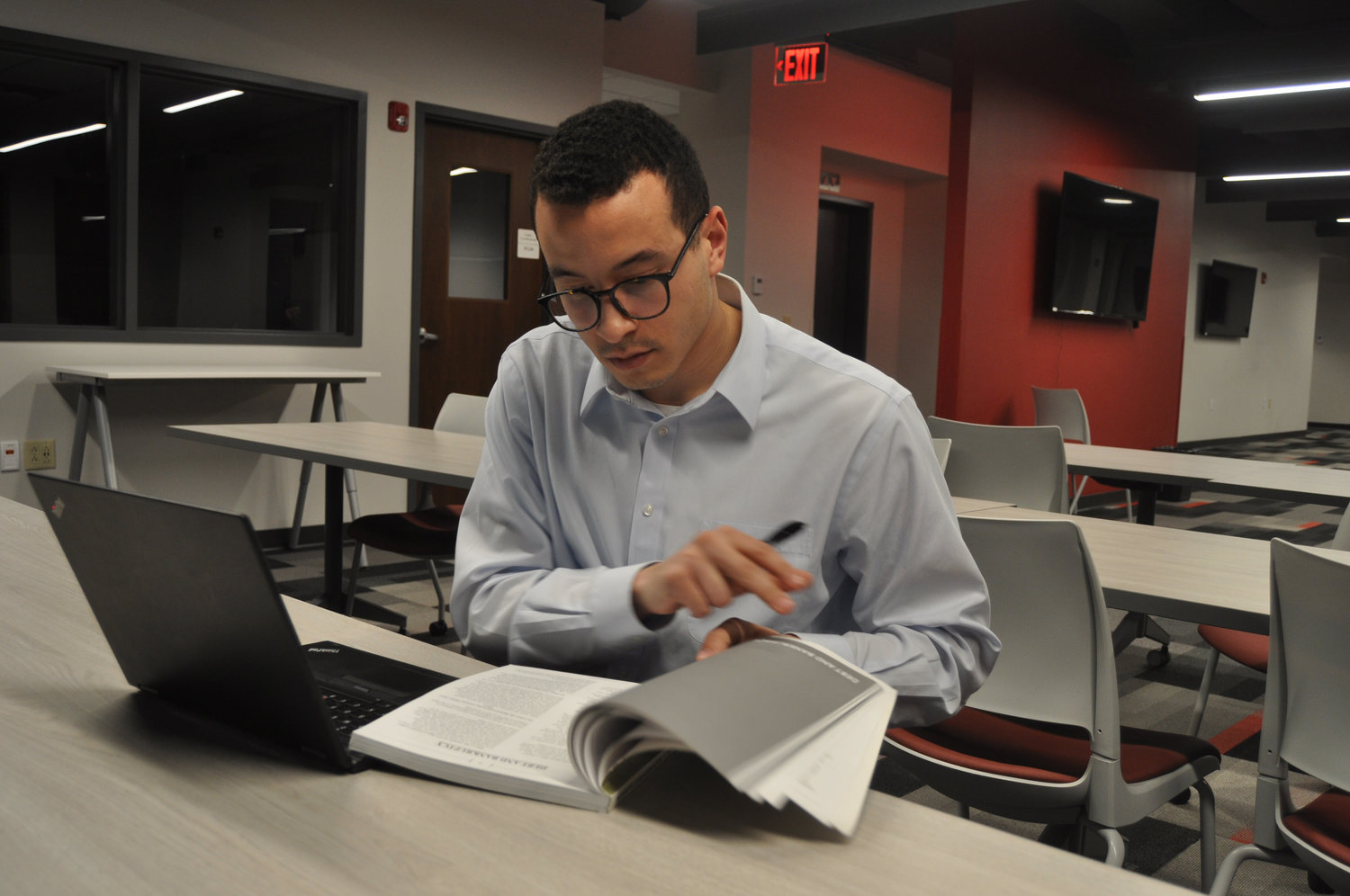 Attorney Zach Mahone does paperwork Wednesday at the Montgomery County Free Legal Clinic at Fusion 54. The clinic offers pro bono advice on civil matters such as family law and specialized driving privileges.