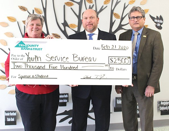 Montgomery County Youth Service Bureau Executive Director Karen Branch, left, receives a check made out to the bureau for $2,500 from Tri-County Bank & Trust Vice President Steven McLaughlin and Tri-County Bank & Trust President and CEO Chuck Dixon.