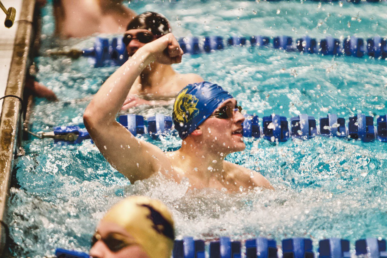 Crawfordsville's Jack Pendleton celebrates a win in the 50 freestyle.