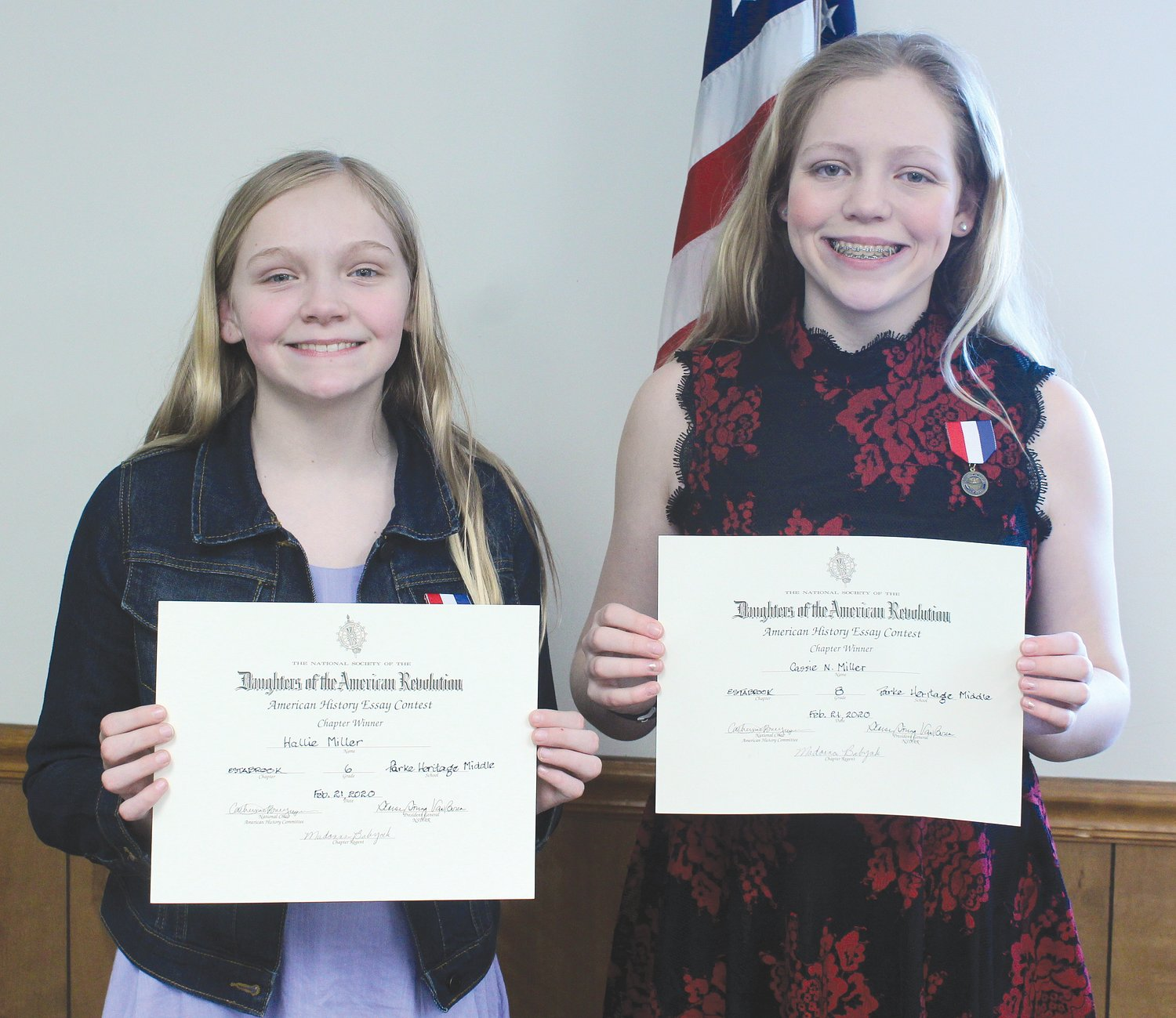 "The members of the Daughters of the American Revolution organization recognized the winners of their essay contest in a special ceremony Feb. 21 at the Parke County fairgrounds meeting room. Grade winners were sixth grade, Hallie Miller, and eighth grade, Cassie Miller, both of Parke Heritage Middle School. The essay topic was ""The Voyage of the Mayflower."" The essays advanced to the state level. Both Hallie and Cassie placed second in the state and will be honored at a banquet May 17 in Indianapolis. Pictured are Hallie, left, and Cassie are the daughters of Matt and Melanie Miller of Tangier."