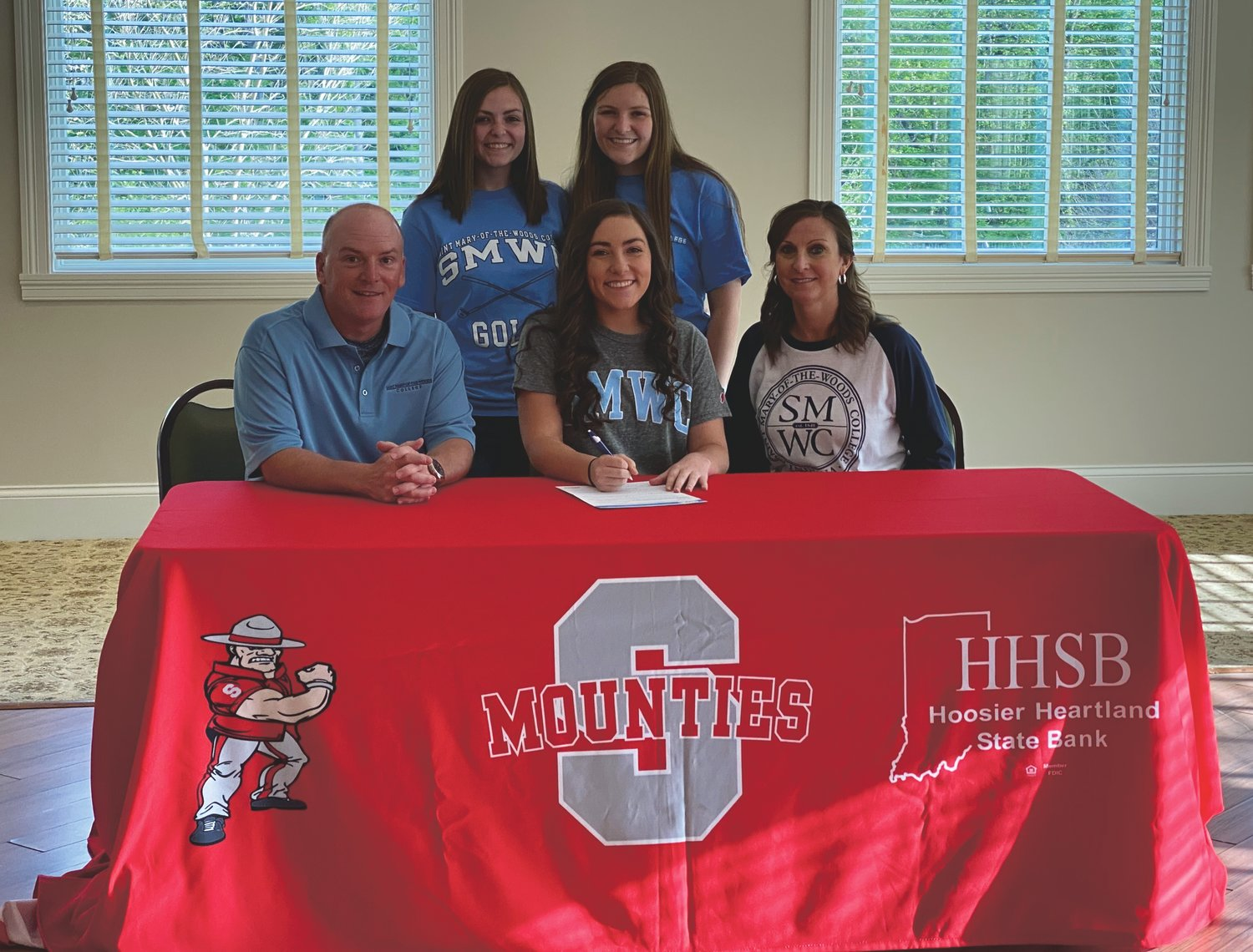 Southmont's Bailey Thompson will continue her golf career at St. Mary-of-the-Woods. She was joined by family and friends on Friday night to celebrate her commitment. PICTURED ABOVE: Thompson is joined by her parents Brian and Lori Thompson, and sisters Payton Jones (Thompson) and Hannah Thompson.