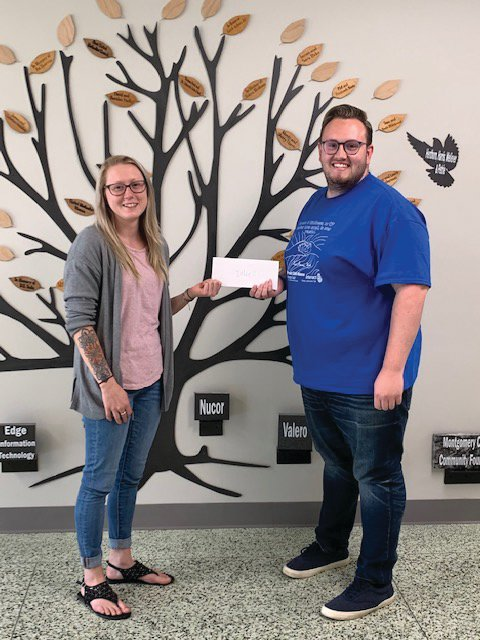 Maddy Edmiston of Integrated Wellness accepts a Drug Free Montgomery County mini-grant from Youth Service Bureau mini-grant coordinator Cameron Cole.