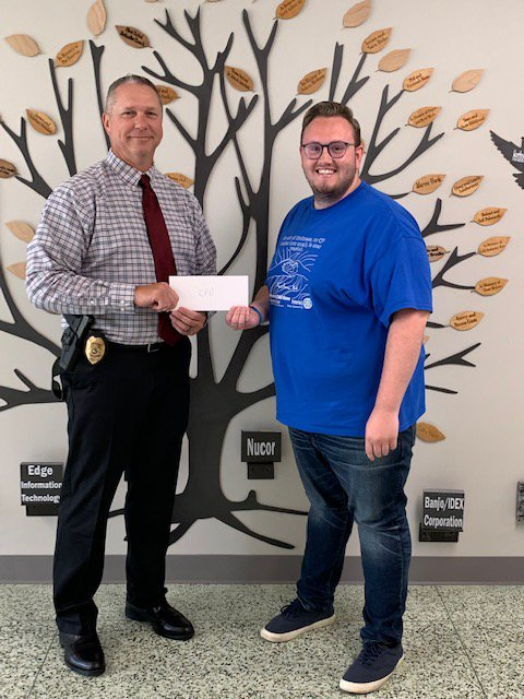 Crawfordsville Police Chief Mike Norman accepts a Drug Free Montgomery County mini-grant from Cameron Cole, mini-grant coordinator for the Youth Service Bureau.