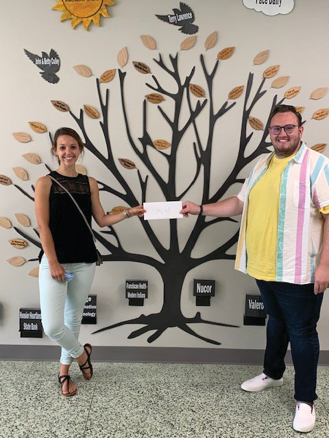 Samantha Cravens of the Montgomery County Health Department accepts a Drug Free Montgomery County mini-grant from Cameron Cole, mini-grant coordinator for the Youth Service Bureau.