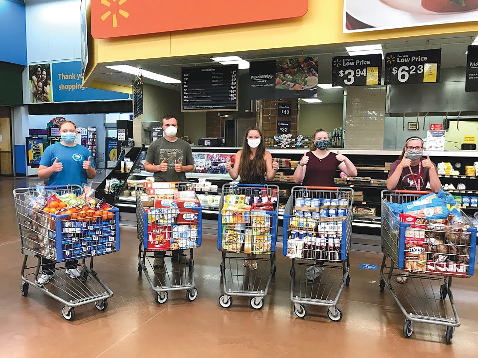 Junior Leaders, from left, Jenna Bushong, Drew Runyan, Ellen Laffoon, Morgan Swick and Grace Simpson shopped to help restock the local FISH Food Pantry.