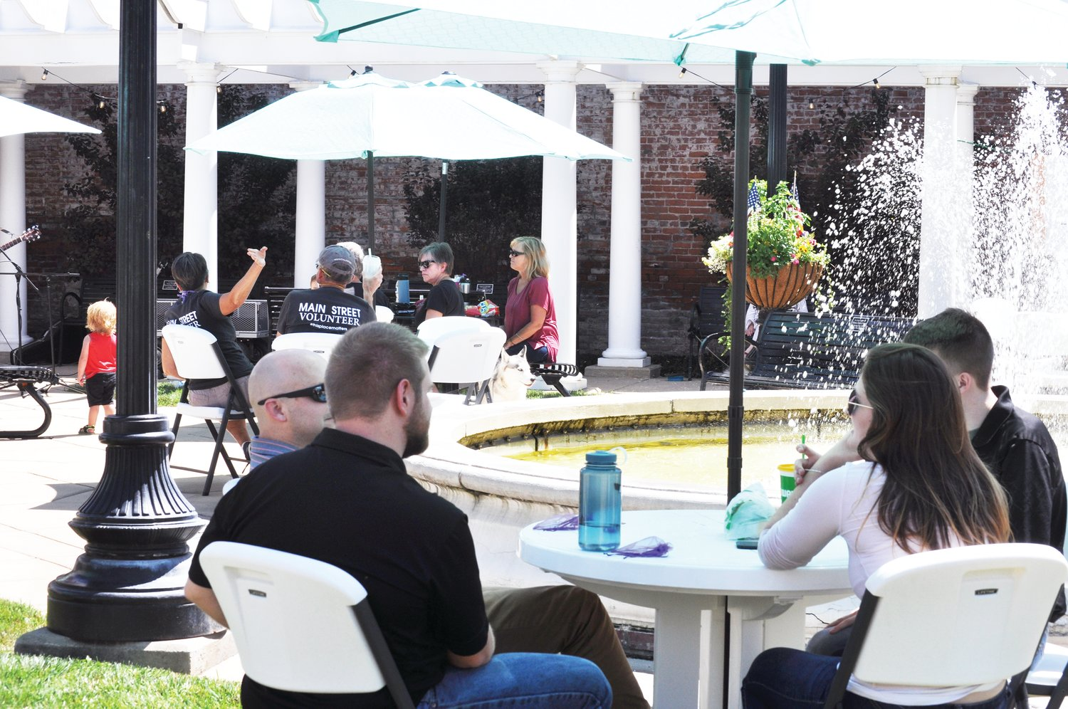 "Crawfordsville Main Street's Lunch on the Plaza 2.0 returned to Marie Canine Plaza, shown here, Friday. Rock and soul artist Claire ""Sheeza"" Tchoula performed live music as listeners brought carryout lunches to the plaza. The series is scheduled to continue Aug. 21 with music from Sharon McKnight."