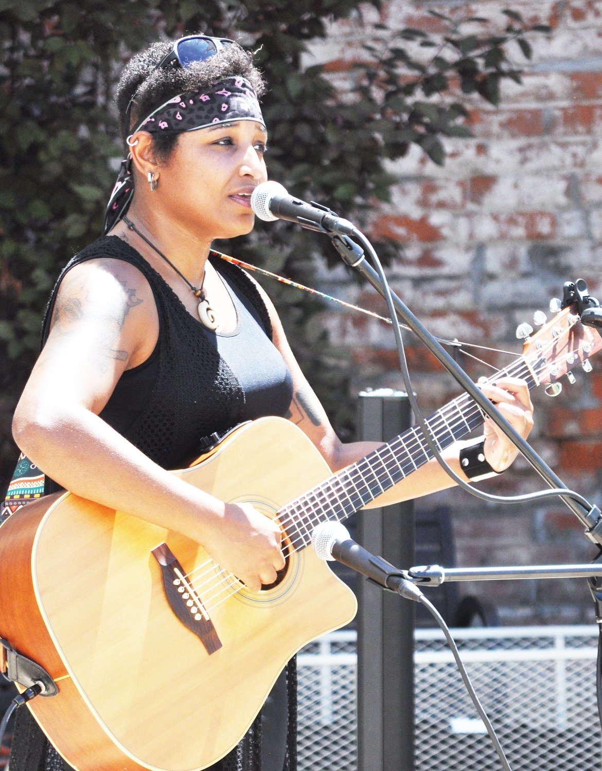 "Claire ""Sheeza"" Tchoula performs during Lunch on the Plaza 2.0 at Marie Canine Plaza Friday."