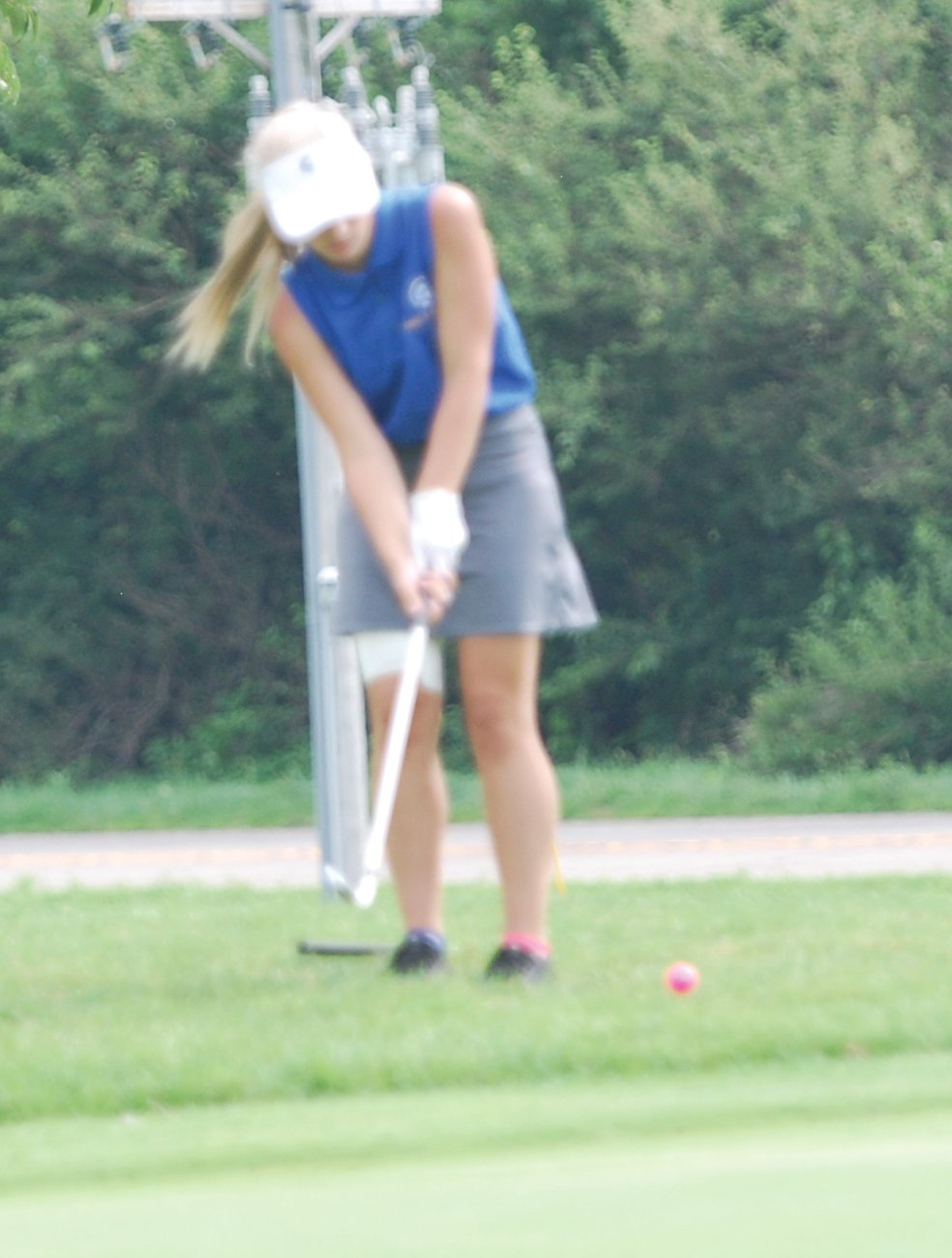 Crawfordsville's Sadie Walker chips a shot toward the hole during the Seeger Invite on Monday afternoon.