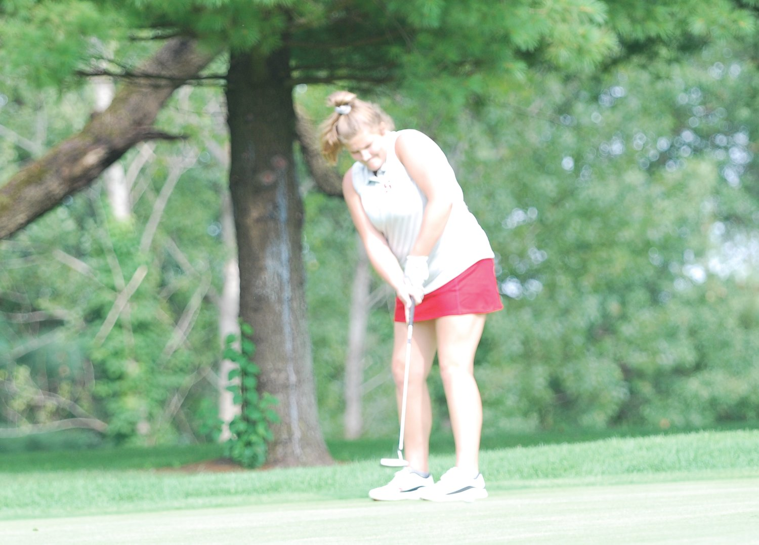 Southmont's Macie Shirk putts on the No. 17 par 3 at Harrison Hills Golf Course Monday afternoon during the Seeger Invitational. Shirk shot a personal best 91 to lead the Mounties.