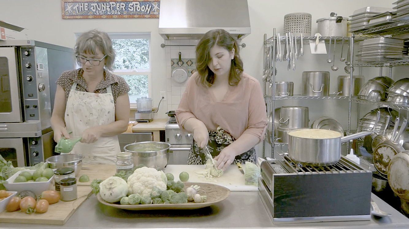 Lali Hess and Brittney Terry of The Juniper Spoon prepare a Costa Rican cabbage slaw.