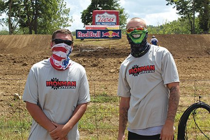 North Montgomery graduates and Crawfordsville residents Seth Beasley, left and Brandon Conkright work security at Ironman Raceway on Saturday.