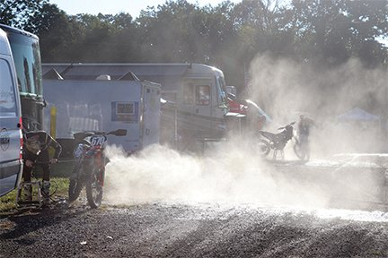 Riders spray off their bikes at the Ironman Pro Motocross on Saturday.