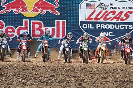 Riders hit the gas as the gates fall on Saturday at the Ironman National Lucas Oil Pro Motocross.