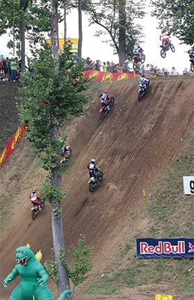 Riders climb 'Godzilla' on Saturday at the Ironman National Lucas Oil Pro Motocross.