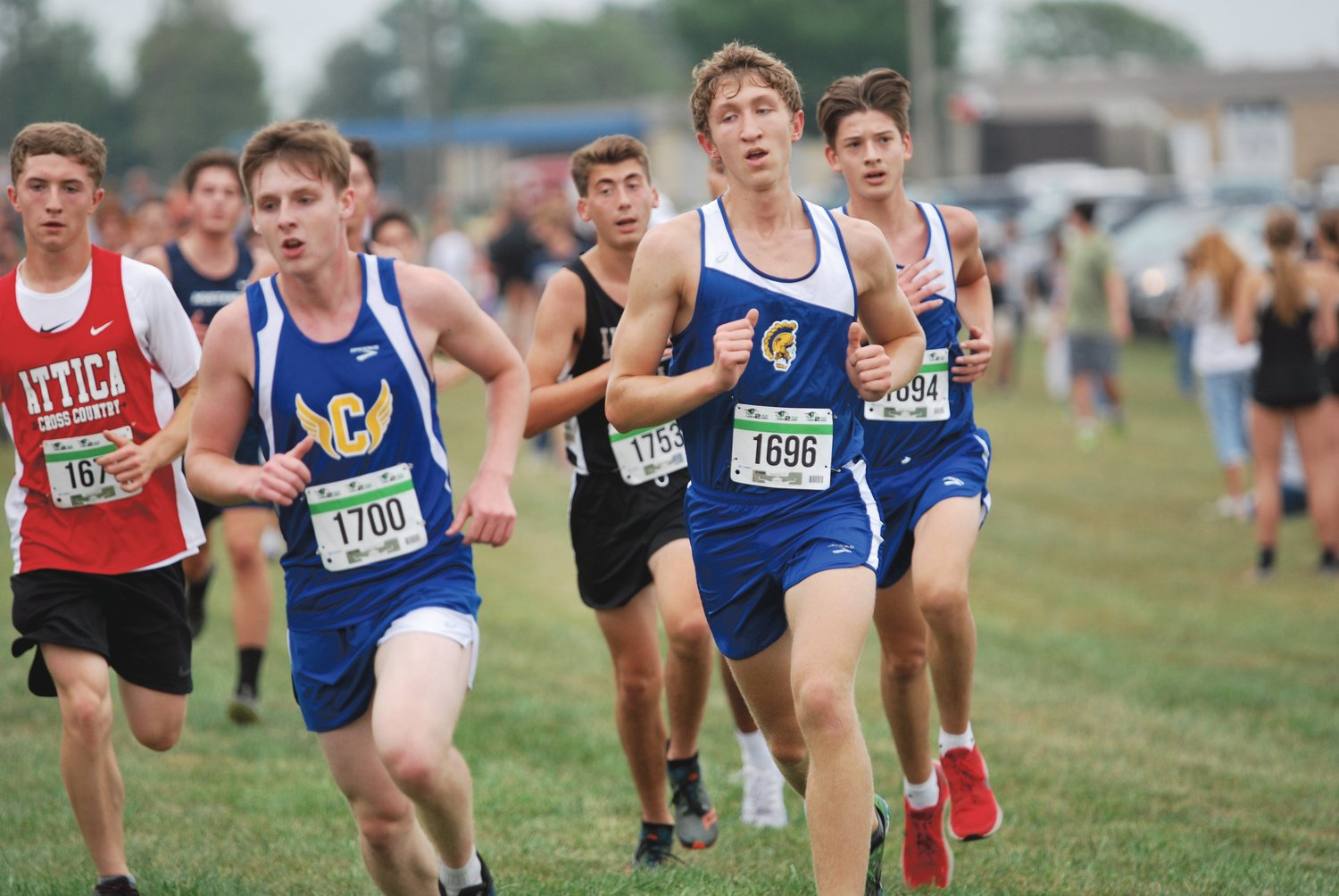 Crawfordsville's Nathaniel Million, Ian Hensley, and Roman Contreras pack run for the Athenians at the Charger Classic on Thursday.