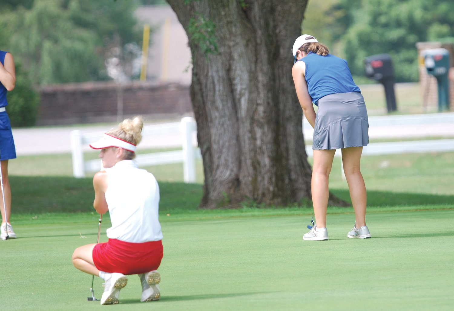 Crawfordsville's Gwyn Redding putts on No. 18 at the Crawfordsville Country Club. The senior shot a 112 at the Sagamore Conference meet.