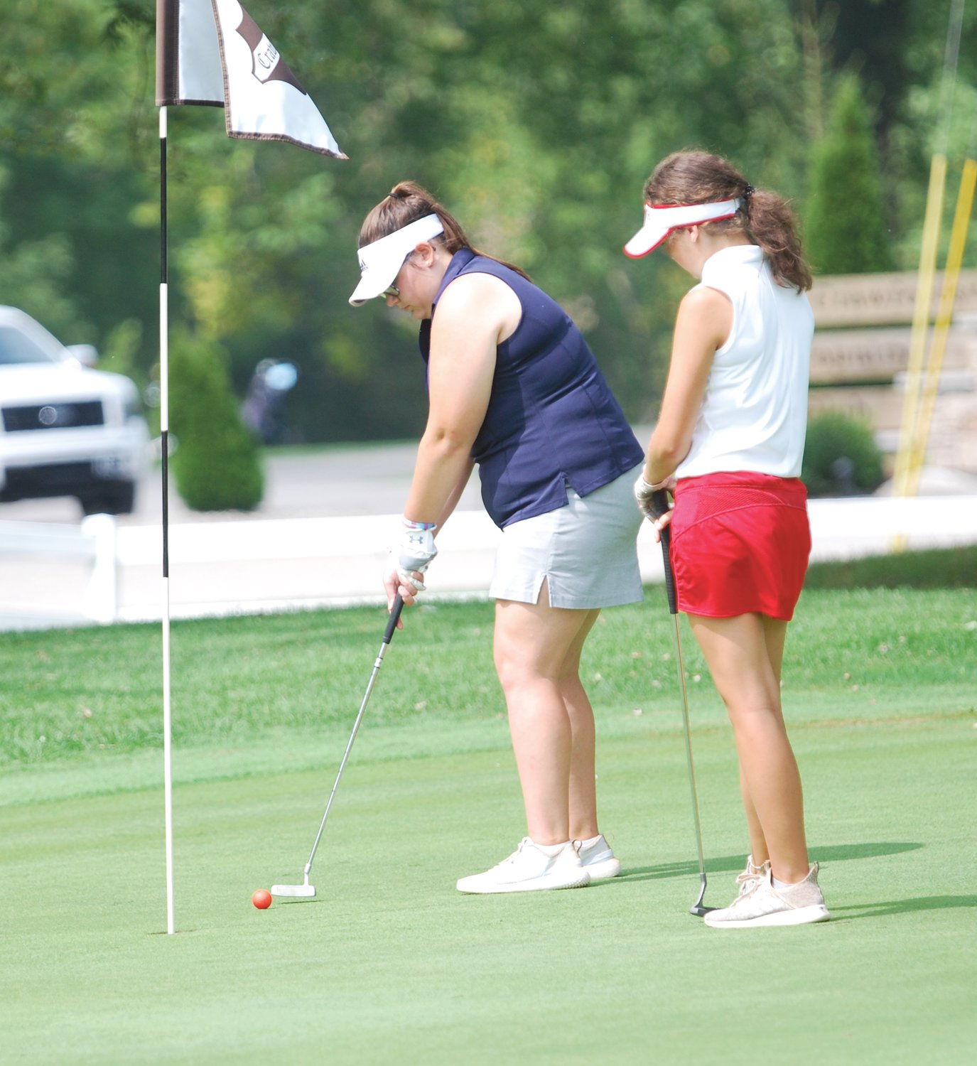 North Montgomery's Ella Stultz has a short putt on No. 18 at the Sagamore Conference meet. Stultz shot a 117 for the Chargers.