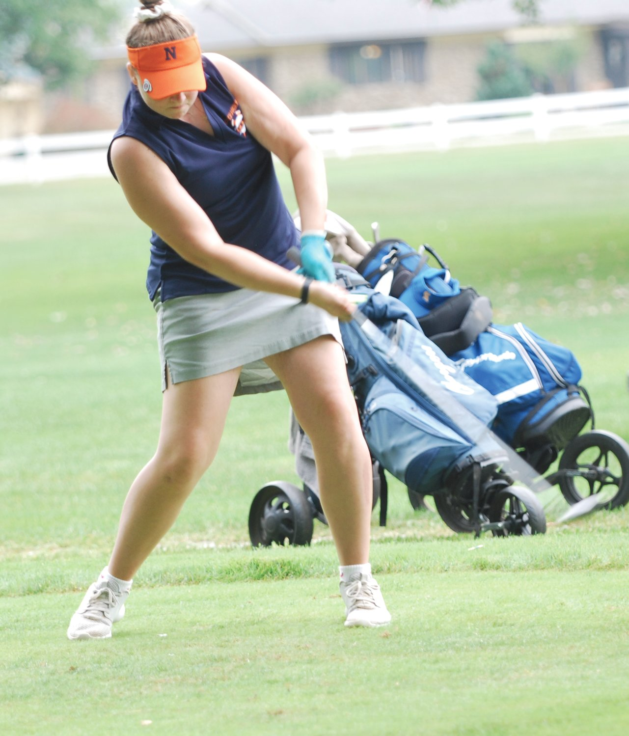 North Montgomery's Morgan Swick tees off for the Chargers on Saturday at Crawfordsville Country Club.
