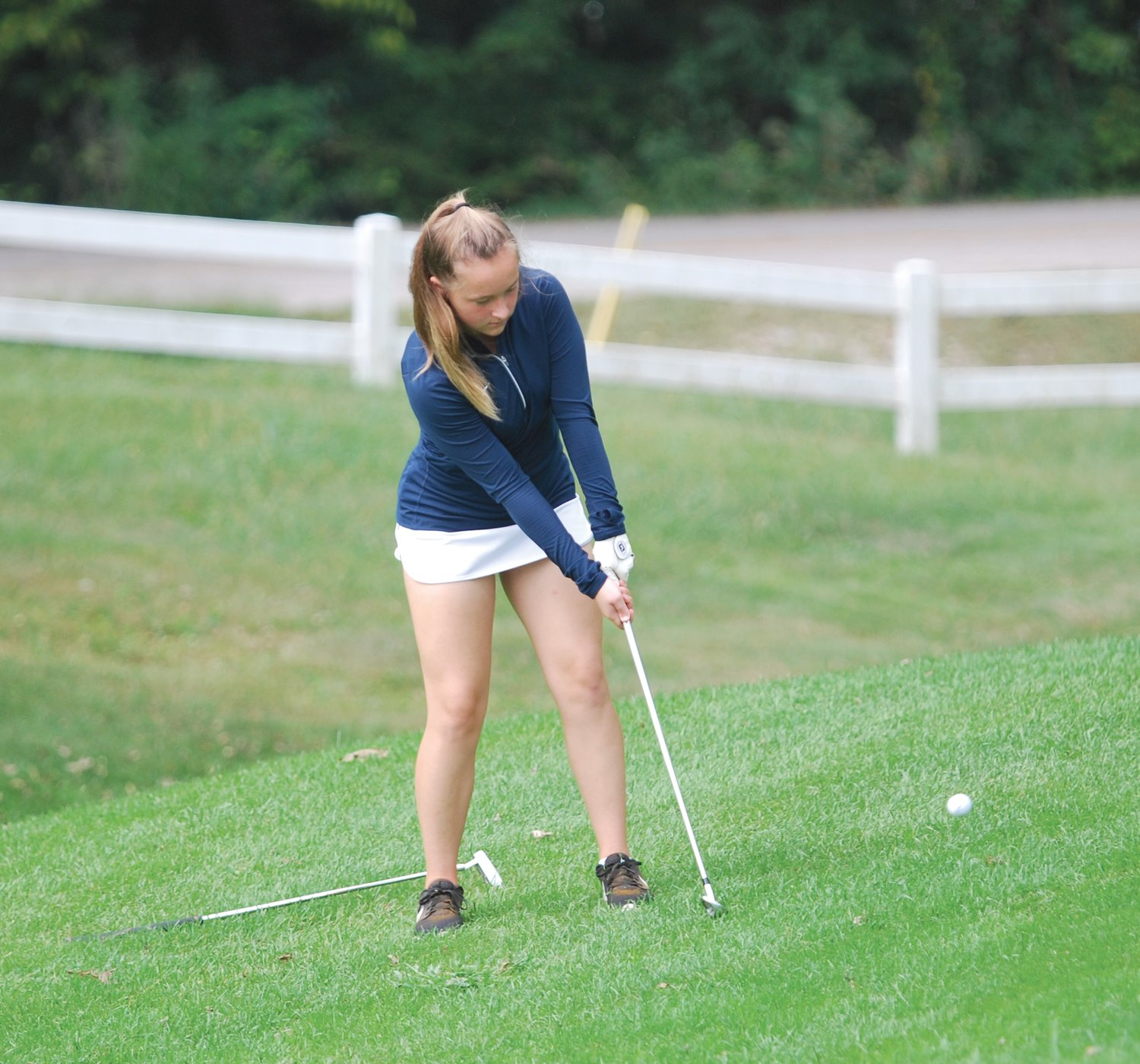 North Montgomery's Maggie Yeager chips toward the green on No. 18 the Crawfordsville Country Club on Saturday.