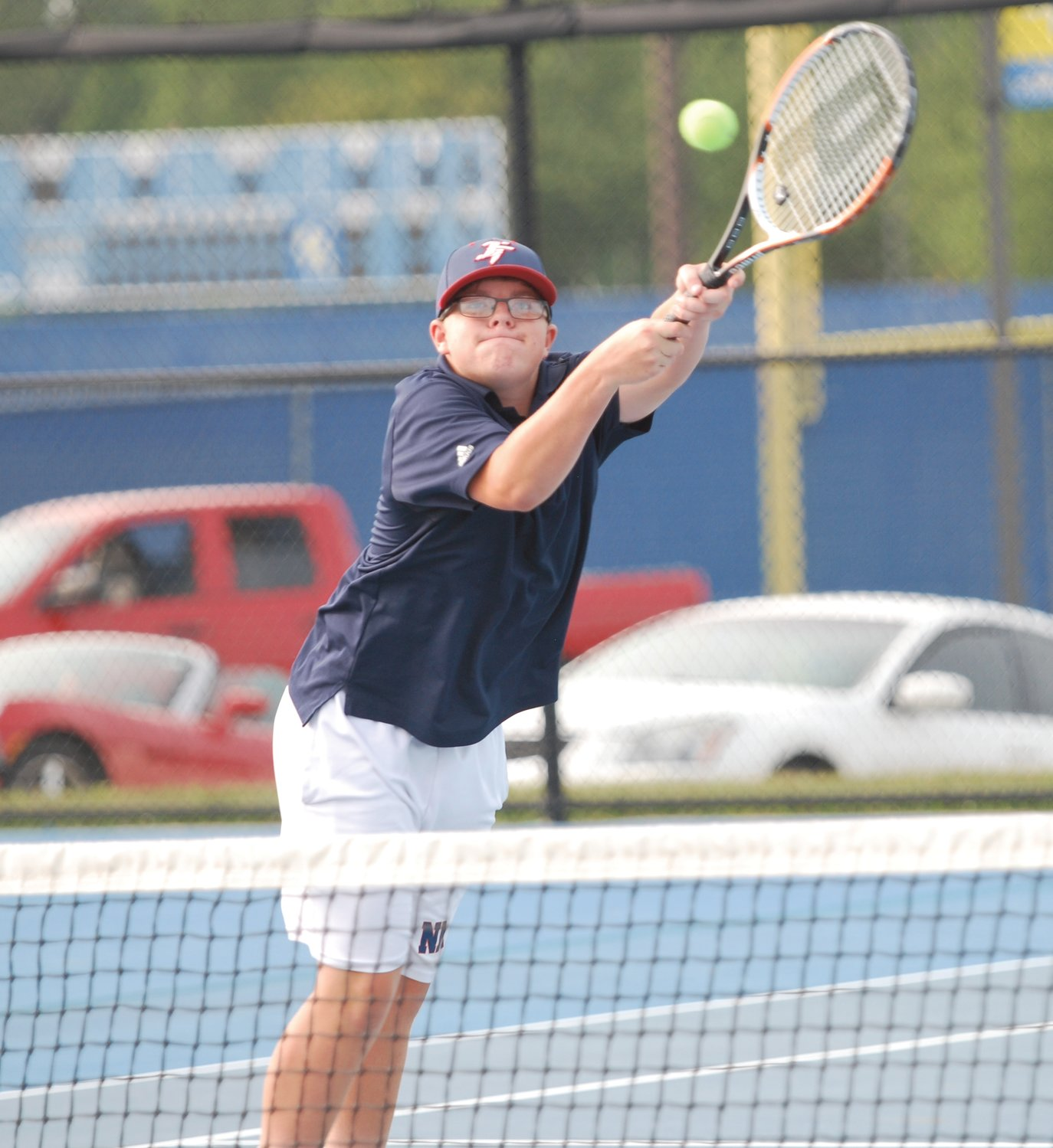 North Montgomery's Hayden Turner returns a shot on Monday during his No. 2 doubles match against Crawfordsville.