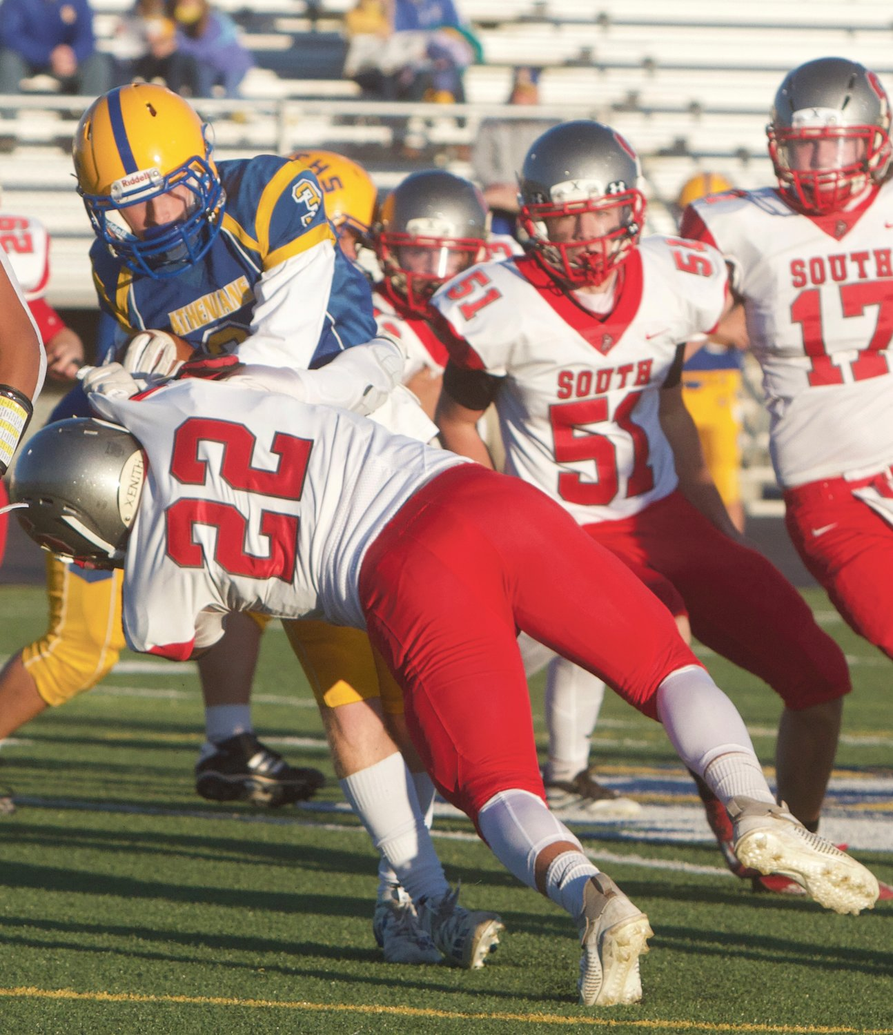 Southmont's Wyatt Woodall makes a diving tackle against Crawfordsville.