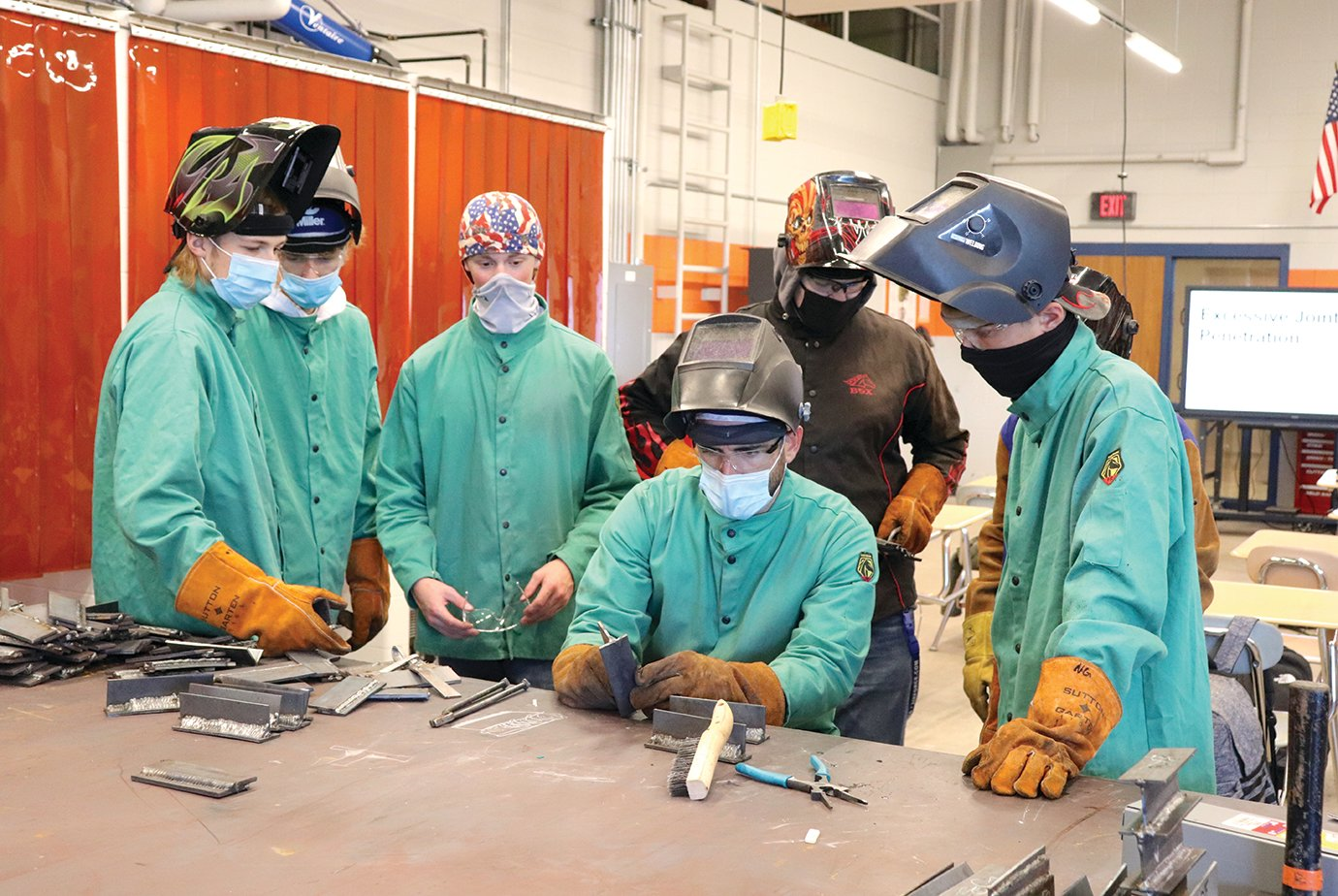 Students enrolled in a new welding program at North Montgomery High School, in collaboration with West Central Indiana Career and Technical Education Center, observe the technique of veteran instructor Jeff Harp, seated, inside the school's renovated manufacturing wing. Students alongside Harp include Gavin Haltom, from left, Noah Hudeson, Sean Kilgour, Jarrett Weder, Timothy Coffman and Nate Gray.