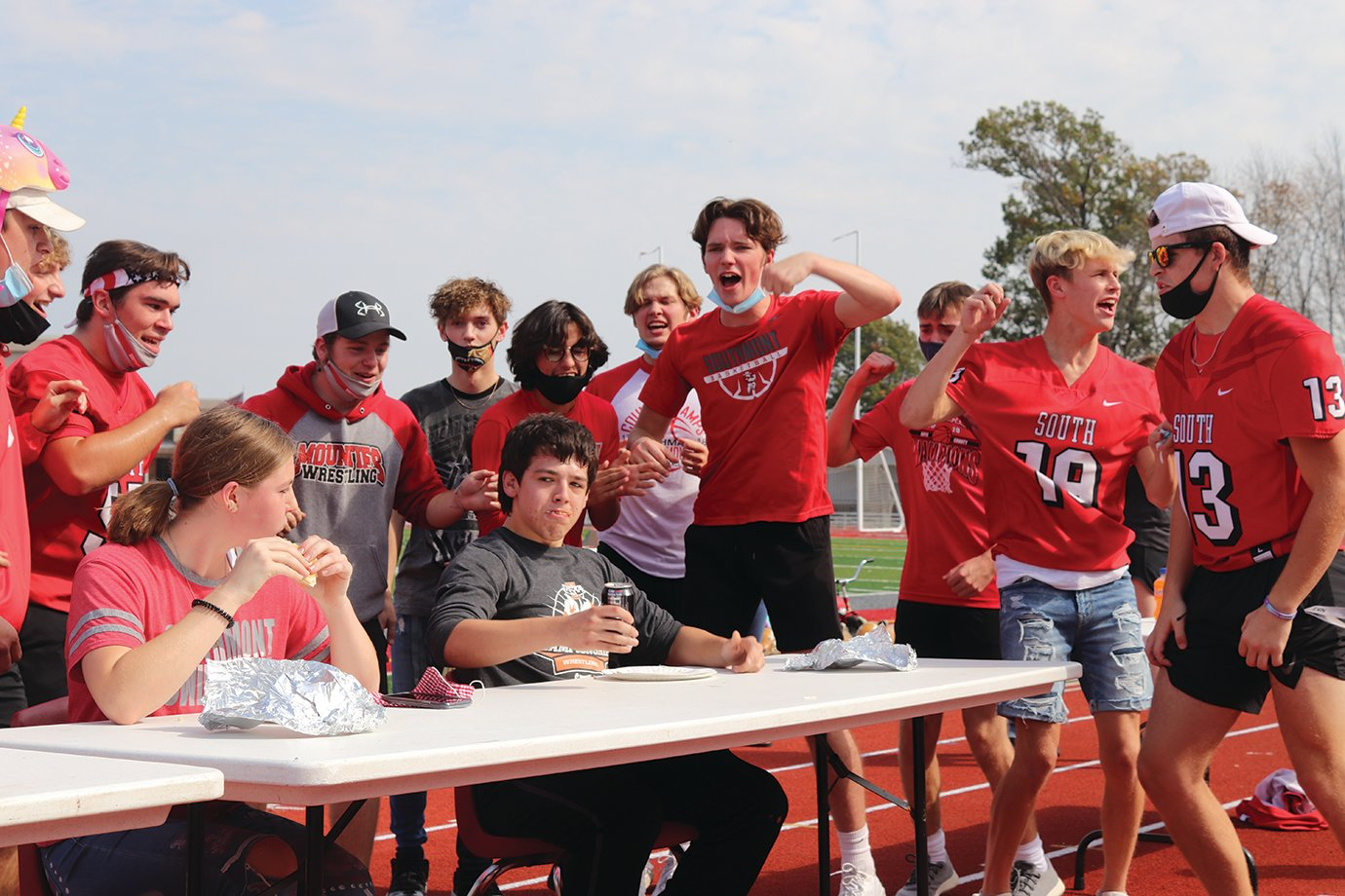 South senior Evan Francis, seated, eats his way to White Castle-eating contest champion.
