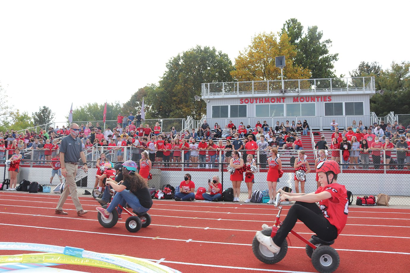 Students of all grades participate in a tricycle relay race at Southmont. Racers had to exchange helmets, eat several marshmallows and chug a pop during each leg of the race.