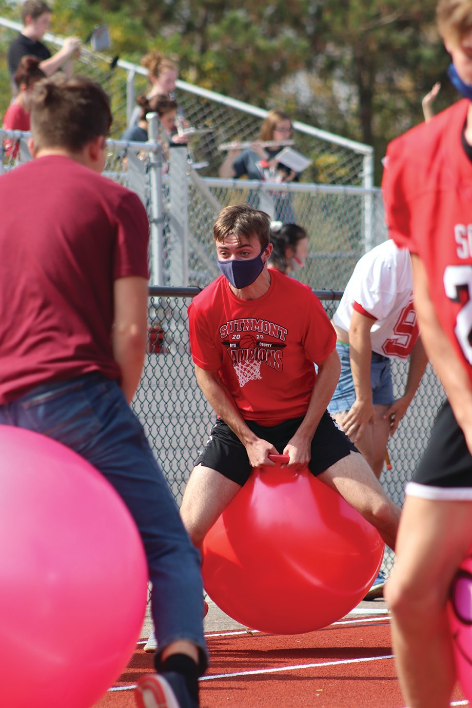 Participants of the hippity hop relay race make their way down and back on Southmont's track Friday.