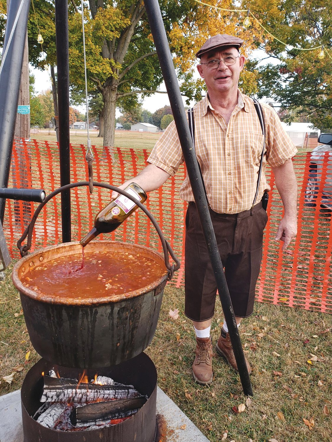 Phil Pirtle cooks goulash over a fire during Oktoberfest 2020 at the Waynetown Park.