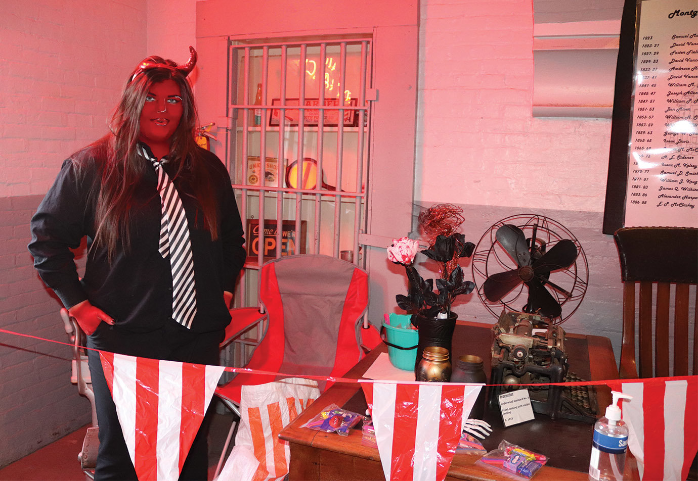 Board member Bethany Moyer dawns a devilish demeaner Saturday along a scary tour of the Old Jail Museum.