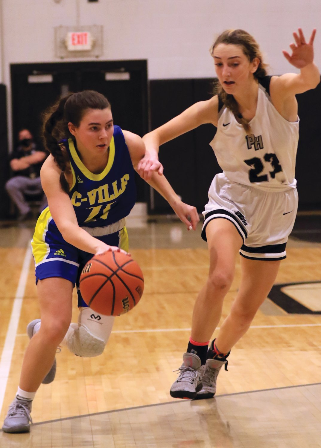 Crawfordsville's Liddy McCarty drives to the hoop against Parke Heritage on Saturday. The junior had five points in a 44-37 loss for the Athenians.
