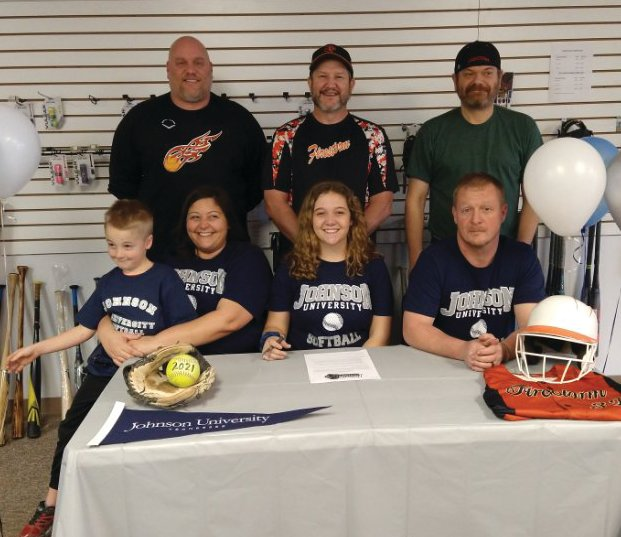 Local softball player Adison Hawk was joined by family and coaches to celebrate her commitment to Johnson University.