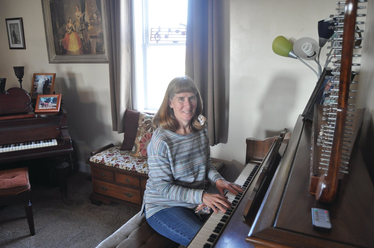 Cindy McCormick sits at the piano in her home. McCormick retired from New Market Elementary in December after a 42-1/2 year career as a music teacher.