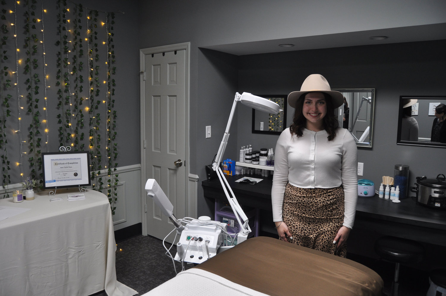Demi Haas stands in her business djh esthetics and brows in the Weemickle Building in downtown Crawfordsville. Haas shares the space with Lilly Wallace's women's fashion store, Maive's Boutique.