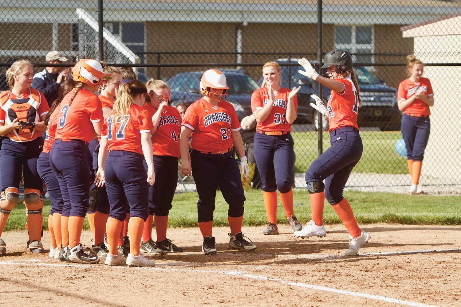 The Chargers celebrate after a Makinze Rominger's home run.