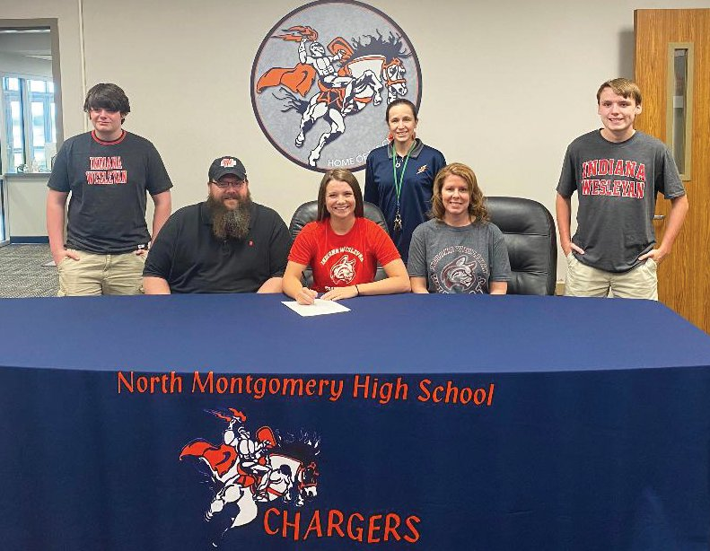 North Montgomery senior Sidney Campbell will continue her swimming and academic careers at Indiana Wesleyan this fall.  She is joined by her brothers, Colin and Wil Campbell, parents, Jon and Martha Campbell, and North Montgomery swimming and diving coach Erin Yeager.
