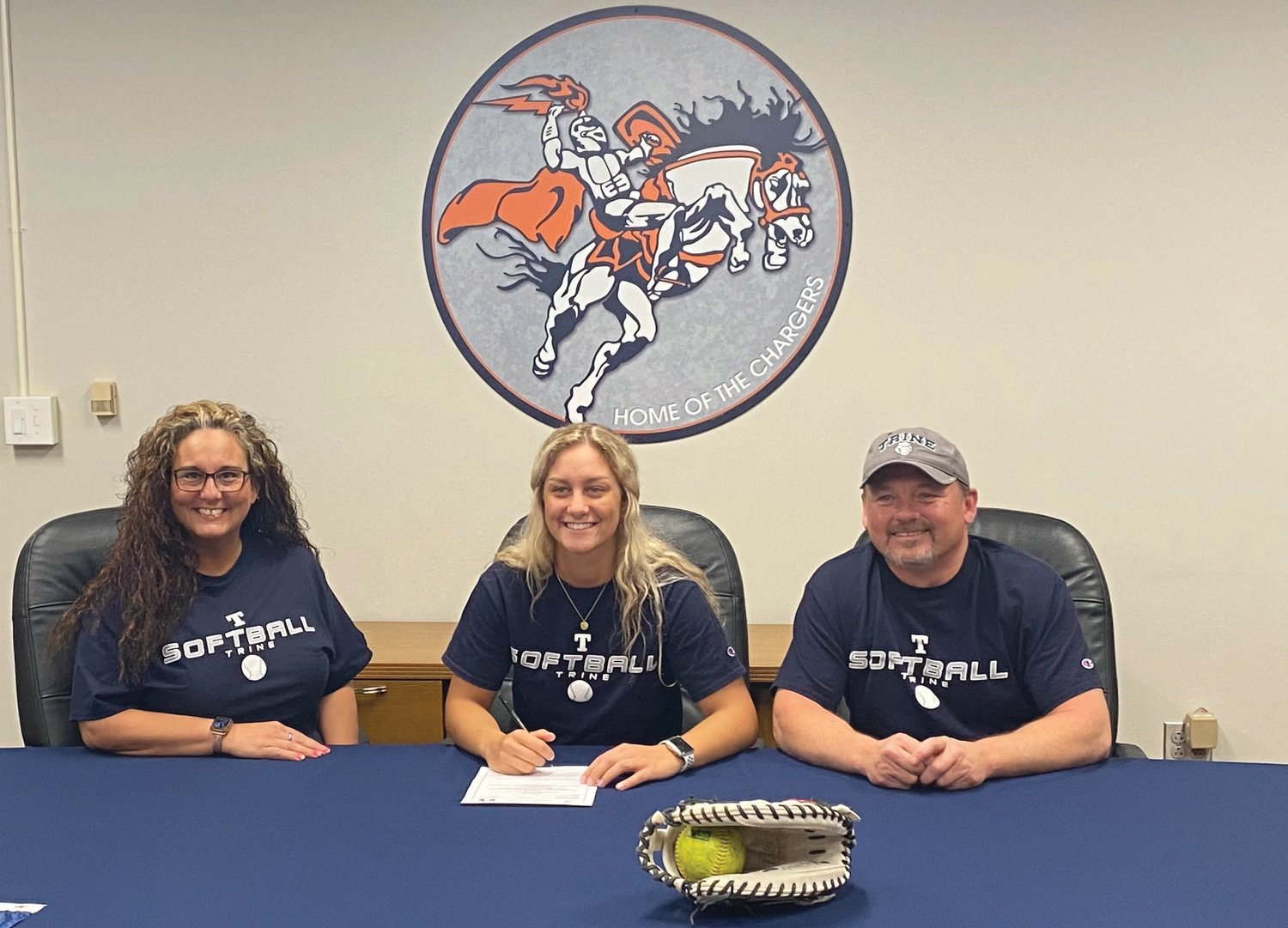 North Montgomery's Makinze Rominger is joined by her parents Shannon and Eric Rominger to announce her commitment to play softball at Trine University.