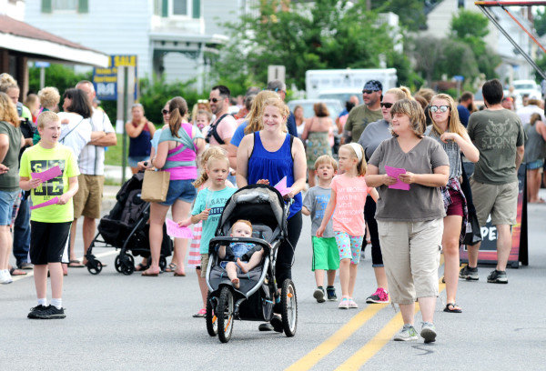 SmyrnaNightOut9-MCleryFamilies walk along Commerce Street during Smyrna's Night Out on Friday. Delaware State News/Marc Clery