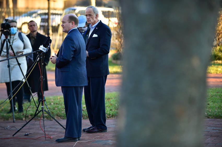 U.S. Senators Chris Coons, front, and Tom Carper give a press conference on Thursday at Tubman-Garrett Riverfront Park in downtown Wilmington.