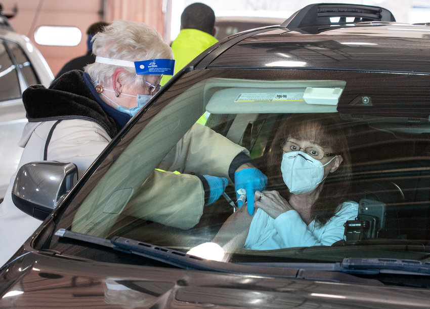 Delaware Medical Reserve Corp. Volunteer Cindy Horsman gives Kay Symonds a dose of the Moderna COVID-19 vaccine during a drive thru at the Harrington Fire Station on Saturday.
