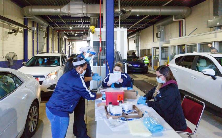 Bayhealth Medical Team prepares to administer COVID-19 vaccines at the DMV drive through vaccination clinic.