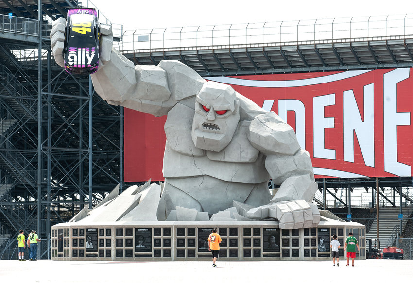 A few race fans, not the usual hundreds walk near the Miles the Monster statue in the FanZone at Dover International Speedway. Fans were not permitted to watch the race due to COVID-19 conditions during NASCAR race weekend in Dover.