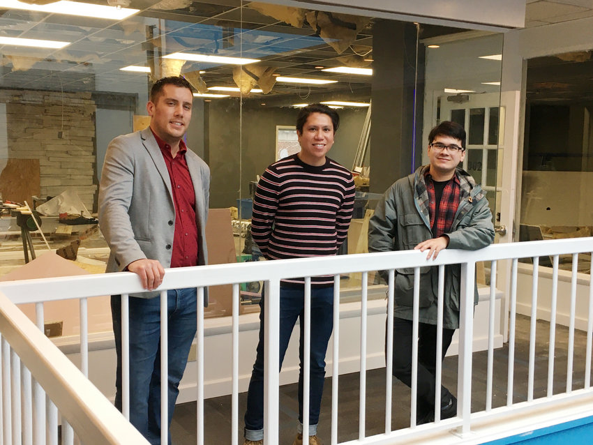 City Center owner Bret Davis, left, Milton Theatre Marketing Manager John Paul Lacap and General Manager Mangus Steed stand outside a third-floor space that will become a new theater in Downtown Salisbury called Revival.