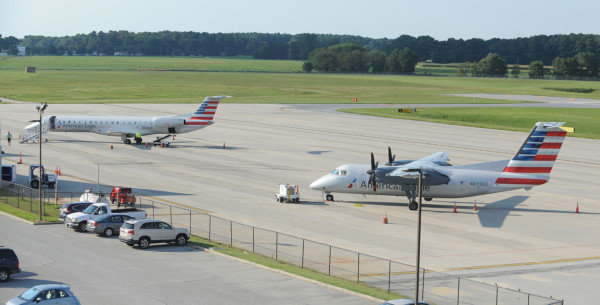 Jet service at Salisbury-Wicomico Regional Airport became available in 2017 through American Eagle and Piedmont Airlines. At left, one of the new E-147 Embraer jets prepares to load for a flight to Charlotte, N.C. At right, one of the venerable Dash-8 turbo-props that has served Salisbury for many years prepares to depart for Philadelphia. The jets will fully replace the prop-planes, which are on a retirement schedule, sometime during 2018.