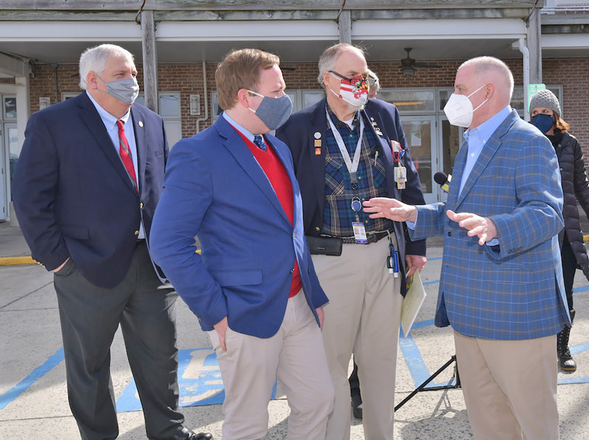 Maryland Governor Larry Hogan visited a vaccination clinic in Cambridge on Friday. The site is in space donated by the Hyatt Resort. Gov. Hogan, at right, is seen speaking to, from the left, County Council Member Lenny Pfeffer (District 4), Cambridge Mayor Andrew Bradshaw and County Health Officer Roger Harrell.