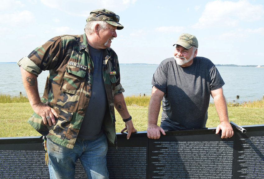 "Vietnam veterans Frank Bolen Sr., left, of Dagsboro and Jim Jensen of Ocean View chat following setup of ""The Wall That Heals"" during its October 2019 stop in Ocean View. The exhibit will be making another trip to the area in April."