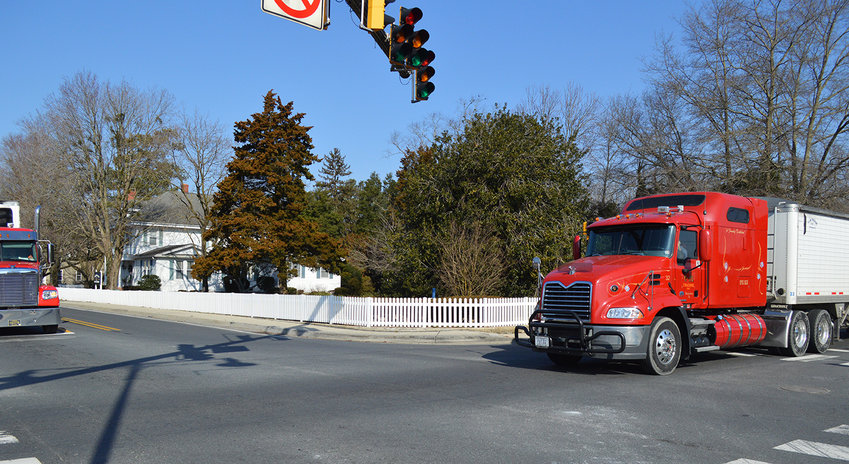 Truck traffic at the intersection of Washington Street and State Street in Millsboro is being addressed in efforts to reduce damage to fencing at the Williams Conference Center, owned by Delaware Technical Community College.