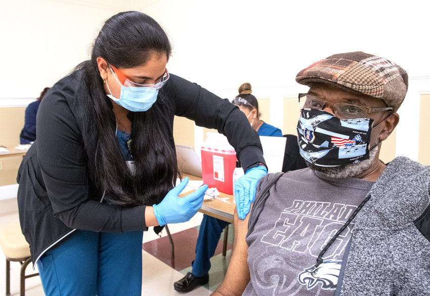 Roma Patel gives Harold Hosten his second Covid-19 vaccination at the Modern Maturity Center in Dover on Thursday.