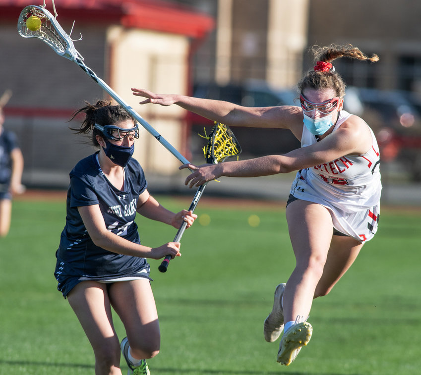 Polytech's Elizabeth Szell loses her stick as Sussex Academy's Emily Moody puts on the pressure in the first half at Polytech on Friday..